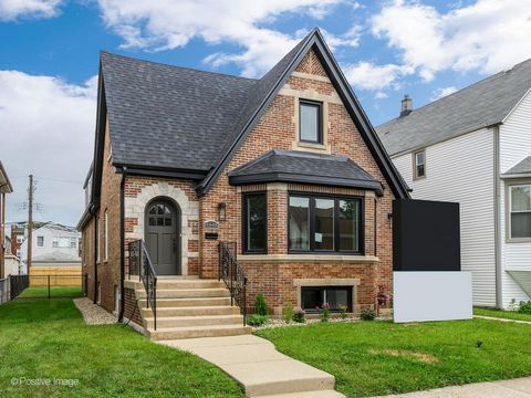 Another great redevelopment by MK Construction and Builders - No detail has been missed with this gut rehab STUNNER. Don't be fooled by this beautiful English Tudor as it's MUCH larger than it appears! It sits across a double lot and features 6 bedro...