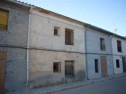 Traditional village country house for restoration with a bodega. Structurally sound. A small patio links the house and bodega together. Access from two roads. Bodega is ideal for use as a garage or for storage. Roof does need some work, as do the doo...