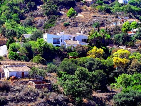 For Sale direct from the owner! This house is unique and will accommodate many aspirations of forward looking buyers. The photos and information below will set the stage for a house that fuses Spanish countryside exterior and services, a Northern Eur...