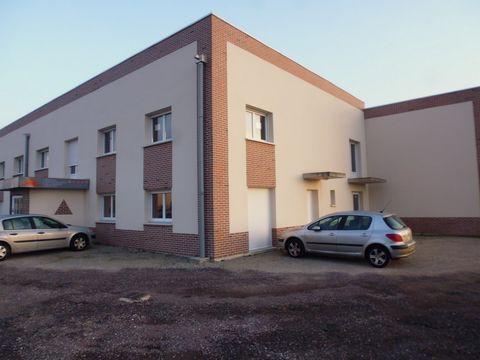 Guichainville, nous vous proposons un ensemble immobilier professionnel de construction récente, comprenant 10 lots pour une surface totale de 1 706 m