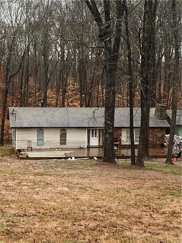 Located in Alpharetta. 5 Acres in prime Alpharetta area... South Forsyth. Old ranch home in need of total renovation or is a tear down. Full unfinished basement. Or you can subdivide and build several homes.