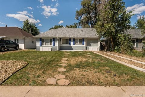 **Happy Hour Open House Friday 9/17 4-6 pm** Enjoy one-level living in this bright, updated Chaffee Park home. Enter the inviting living room which welcomes you with coved ceilings and two large windows letting in tons of natural light. The open floo...