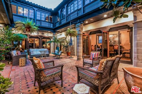 Historic Bradbury House. Designed by architect, John Byers for Lewis Bradbury Jr, the house is composed of adobe walls, exquisite tiles and heavy carved wood accents throughout. This is a spectacular bluff top estate with the house, garden and pool s...