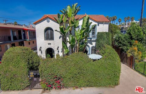 Large, gated, sunshine infused Hollywood Spanish duplex with 2 units, each with 2 beds and 1 full bath, and plenty of street and garage parking in amazing central location! Both upstairs and downstairs have a private patio for indoor/outdoor living. ...