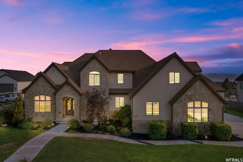 Location, Location, Location!! This 2 story home in the French Country Estates is nestled in one Highland's most desirable and convenient locations. This custom home is 100% finished with tons of upgrades! 7 bedrooms, 2 Full kitchens(MIL APT), sub-ze...