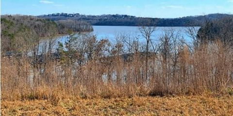 Located in Gainesville. A rare lakefront lot to purchase including a boat slip in Marina Bay! The lot has soft rolling topography so it will be easy to build on! It is walking distance to the club and marina with panoramic lake views and has Southern...