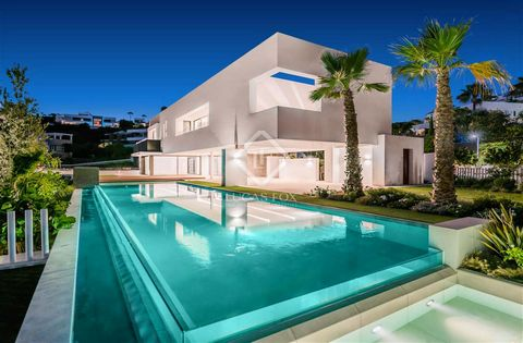 The 3-storey residence of a total of 845 m² (built + terraces) will exude true modern chic: open plan living design, exquisite architectural details, accent walls, floor-to-ceiling windows, glass doors and balustrades, a serene colour palette and sop...