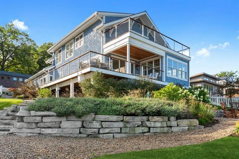 Along the Lake Michigan Shoreline sits a remarkable, newer construction home. This home is located in the highly coveted and most sought out area of Long Beach: a sophisticated retreat for those seeking an incomparable lifestyle along the water's edg...