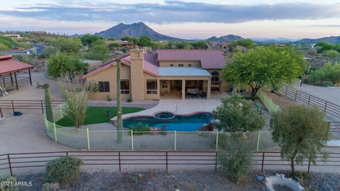 INTERIOR PICTURES COMING SOONDON'T MISS OUT ON THIS ONE OF A KIND MOVE IN READY HORSE PROPERTY ON CAVE CREEK WATER!3 BEDROOM 3 BATH PLUS A DEN, POOL, ATTACHED AND DETACHED GARAGE, 5 STALL MARE MOTEL WITH TILE ROOF, FANS, LARGE STALLS, BIG ARENA AND A...