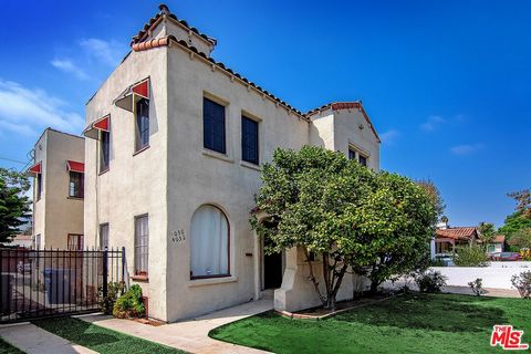 RARE Character Spanish Duplex w/ 2 beds + 1 bath per unit + large shared swimming pool located on a quiet street in Atwater Village, adjacent to Los Feliz and Griffith Park, Glendale. Spacious lawn, wide driveway, covered entry. Bright downstairs uni...
