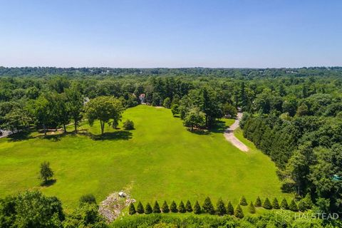 Rare land opportunity for development of an estate compound in central mid-country on a high 7-acre cleared plateau. Beautiful building site with lush park-like grounds, specimen hardwood trees, mature perimeter evergreens, brilliant east west exposu...