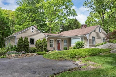 Nestled on a quiet street, abutting North Mianus Park, this renovated and updated ranch sits on an elevated 1 acre parcel. Modern kitchen with fireplace leads to a stone terrace with sitting wall overlooking the expansive rear yard. First floor also ...