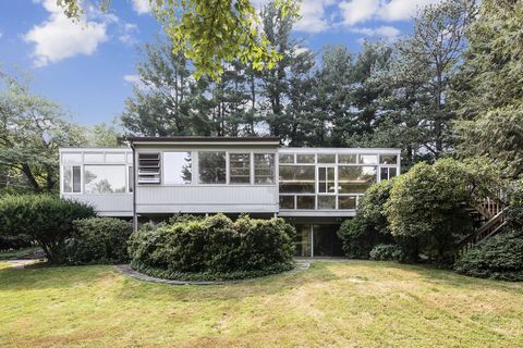 This 1960's Mid Century Modern Retreat is beautifully positioned on two lush acres perfectly complimenting its park-like setting in prestigious Yale Farms, designed to bring nature and light into every room with its 2-story, 5 Bedroom/3 Bath architec...