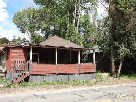 Fixer Upper in an Amazing location in downtown Estes Park. Walking distance to Post Office, Fishing, Downtown Estes, shopping, restaurants, park, and river. Built in 1919. Great home that just needs some TLCZoned Downtown Commercial.