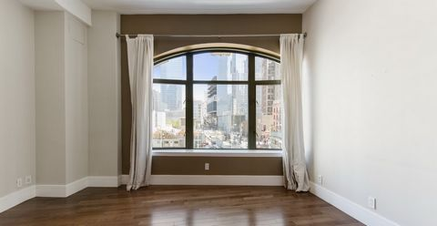 This beautiful one bedroom home features enormous arched windows, 10 and a half foot ceilings, and spectacular views of the Freedom Tower! When you enter residence 3A you are welcomed by a bright open kitchen and a spacious living room graced with a ...