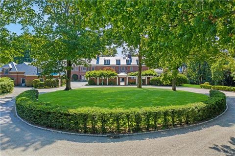 Remarkable Belle Haven Classic Georgian Colonial with only 2 previous owners. The estate sits on almost 6.4 acres. Circular driveway is flanked by a guest house and care-takers cottage. A brick walled inner courtyard leads to the front door. The gran...