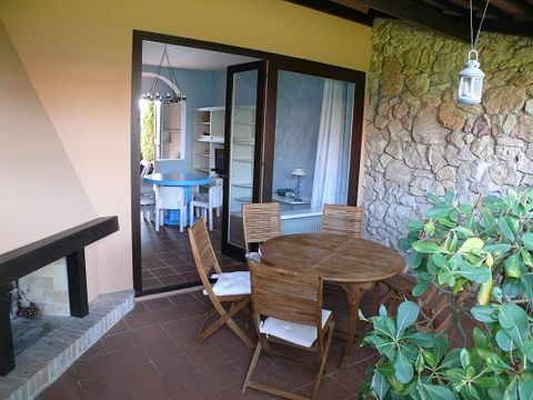 Exclusive residence with swimming pool, park place and porter. Villa with two floors composed by: outside patio with little private garden, wide living room, kitchenette with microwave, store room. The first floor is composed by a double bedroom with...