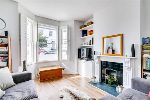 A ground floor apartment arranged as bright reception room with bay window and ornate fireplace, well fitted kitchen with doors to private patio area, two bedrooms and family bathroom. The property totals approximately 591sqft of internal space and i...