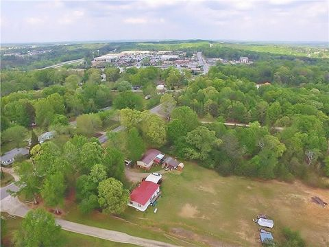 Located in Flowery Branch. POTENTIAL COMMERCIAL. ONE OF TWO LOTS AVAILABLE, CAN BE PURCHASED TOGETHER. EACH LOT IS 2.5 ACRES FOR TOTAL 5 ACRES. PERFECT LOCATION FOR YOUR BUSINESS/OFFICE...MEDICAL, DAYCARE, SALON, ETC-ALL UTILITIES AVAILABLE. HIGH VIS...