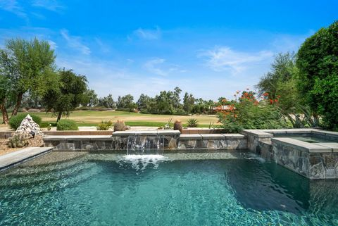 Luxurious Trilogy La Quinta home with sparkling pool and spa, located on the #16 hole at the Coral Mountain Golf Club. This Monarch plan boasts 1845 sqft. of sprawling interior space, including 3 bedrooms/2 baths, plantation shutters, custom window c...