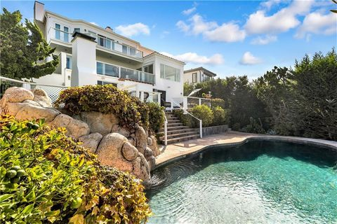 Sited on one of the largest lots of Corona Highlands, this five-bedroom, seaside estate has been extensively remodeled and expanded; utilizing organic lighting, refined materials, and incomparable views. Inspired by the world-famed designer, Christia...