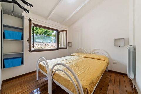 This chalet in Villammare is an ideal place to spend your holidays with family. The 1-bedroom can perfectly accommodate 4 guests with a child. Rejuvenate with your loved-ones at the private terrace with garden furniture, whereas kids can enjoy themse...
