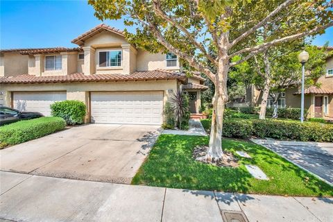 Beautiful Bright & spacious townhome is filled with updates & upgrades. starts with a prime location on a single-loaded street with lots of parking + 2-car attached garage near Tijeras Creek Golf Course. Then adds peaceful canyon views from the priva...