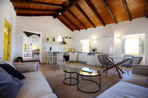 Rustic corner villa with excellent sun exposure in Messines, Algarve. It has 2 bedrooms, of which 1 en suite, open space living room with kitchenette and office area on the top floor. The townhouse is situated in the historic centre, just a 3-minute ...
