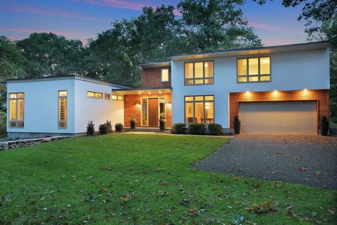 Refined and modern home with glass walls, open spaces and sophisticated aesthetic. Extensive renovation and stunning addition designed by acclaimed architect Joeb Moore in 2013. 1st and 2nd floor master suites. Almost 2 acres on a cul-de-sac with mul...