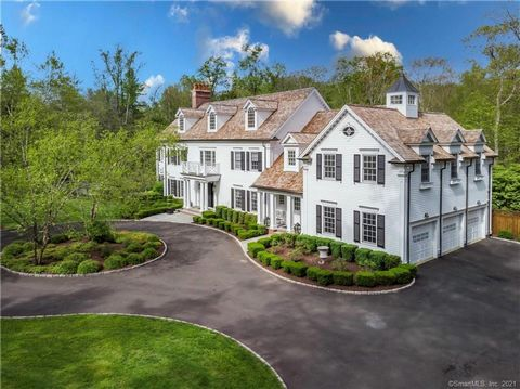 Custom built luxury! From the second you cross of the threshold and enter the double height foyer you experience the grand, sweeping staircase and herringbone oak floors. The bright spacious living room with marble fireplace and coffered ceiling is p...
