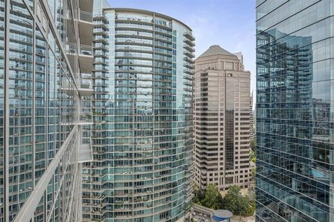 Gorgeous home above the Loews Atlanta Hotel in wonderful location. Fantastic home with spectacular views over the city. Lovely 12 foot ceilings, Brazilian oak hardwood floors and floor to ceiling glass paneled windows. Spacious living area with dinin...