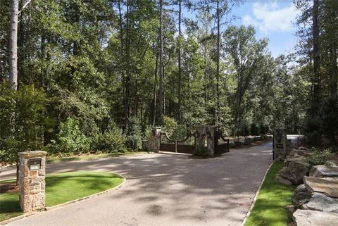 Located in Marietta. Farm at Kennesaw Mountain is a private gated community planned for seven exclusive homes. This lot is 1.20 acres & adjoins the National Park. The subdivision has a large swimming pool, club house & a common play area. Get your ho...