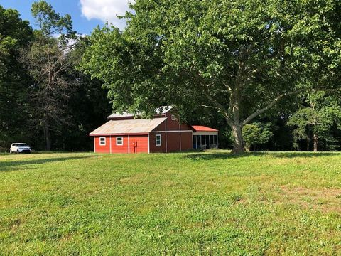 Located in Cumming. Nestled in the Heart of North Forsyth County these 6.8 Level Acres offer MULTIPLE MOUNTAIN VIEW BUILDING SITES, Two Septic Tanks, Electric, Public Water and Well, a Huge Workshop, and Two Driveways. Workshop: Hardiplank Siding, Re...
