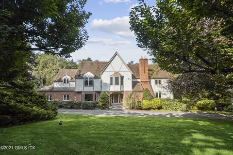 Stunning sunny 5 BR Tudor situated on quiet road adjacent to Mianus River Park with access to miles of trails. Close distance to Ft. Stamford/Goodbody Garden & minutes to downtown Stamford. Cherry trees in circular driveway-abundant parking. Interior...