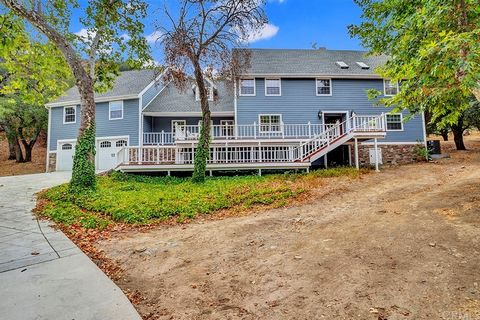 5.1 ACRES OF PURE BEAUTY! Trabuco Canyon Estate, this is a ONE-OF-A-KIND Home/Horse Property with barn is a MUST SEE! No expense or craftsmanship spared on this amazing custom home. The current owner/engineer was very meticulous, designed and could f...