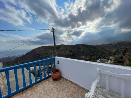 Agios Stefanos-Makrigialos: House on two floors of 75m2 located on a plot of 180m2. The house consists of two bedrooms, a bathroom and an open living area with kitchen. All services are connected. The house enjoys views to sea and mountains and has a...