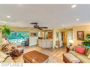 LOVELY MOORINGS 3 BEDROOM POOL HOME...BEAUTIFUL TROPICAL SETTING IN REAR YARD.....PLENTY OF OUTDOOR LIVING SPACE THAT IS SCREEN ENCLOSED.....UPDATED KITCHEN FEATURES CUSTOM CABINETS, GRANITE COUNTER TOPS, AND STAINLESS STEEL APPLIANCES......LANAI IS ...