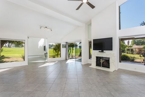 Price reduction - Located within the beautiful gates of Mission Hills Country Club in Rancho Mirage. This lovely 2 bed / 2 bath - 1,596 sq. ft end-unit condo is perched off the 16th Hole of the famed Dinah Shore Tournament course with unobstructed vi...