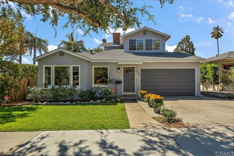 Located on a tree lined desirable street in Sierra Madre steps from park & recreation center is this delightful two story cottage. Spacious living room w/lovely Federal fireplace,coved ceilings & delicate chair rails. Cozy inset dining room, hardwood...