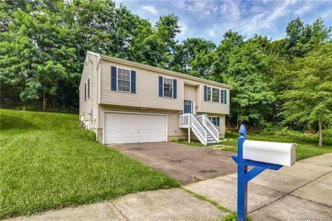Highly desirable 3 Bedroom 2 1/2 Bath home situated on a quiet street in the North end of Bridgeport & located close to major highways with an easy commute to NY! Hardwood floors provide the footprint for the Foyer, Hallway, Living Room & Dining Room...