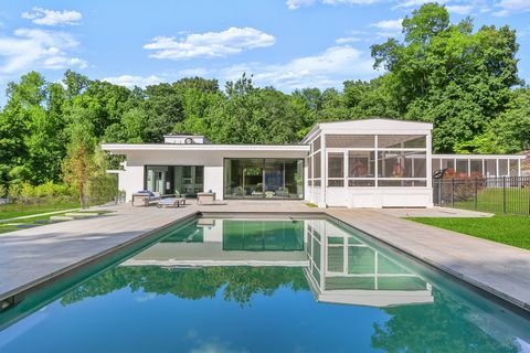 This superlative Mid-Century Modern residence has been deftly redesigned and rebuilt with unsurpassed attention to every detail. Set on 2.48-acres landscaped acres with an open-air floor plan designed by legendary architect Paul Rudolph, its a pricel...