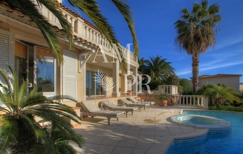 In a residential area of Golfe Juan, neo-provencale villa with sea view A 230sqm living space, large living room of 62sqm with fireplace, fitted kitchen 4 bedrooms and bathrooms including a master bedroom with dressing Landscaped garden with exotic p...