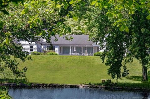 Spectacular landscape overlooking Collins Pond with Dock, privacy, pool, outbuildings (4 garages and workshop) and guest or caretaker apartment. This is truly a remarkable serene setting on oversized lot with magnificent old trees and sun filled terr...