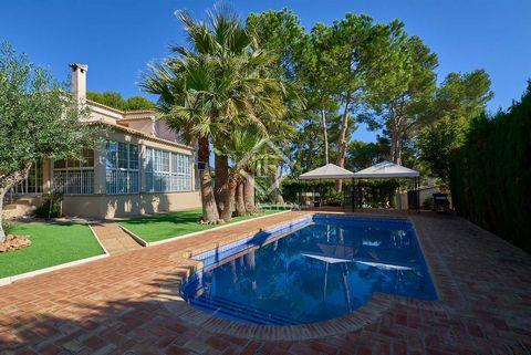The entrance to the house leads to the corridor that gives access to the different rooms on this floor, highlighting a large living room with fireplace, directly connected to a large covered terrace overlooking the garden and the pool. On this same f...