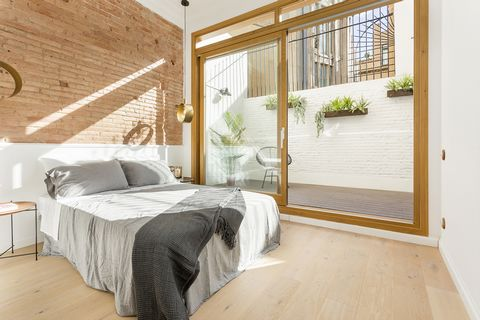 Large walkthrough apartment with private terrace and wonderful high ceilings located on the first floor of property with elevator. Will be handed over completely renovated. This beautiful apartment is located on the Pelayo street in the heart of Barc...
