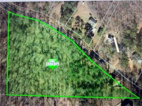 Located in Alpharetta. Exceptional opportunity and a fantastic setting to build your Country Sanctuary in Alpharetta with Cherokee taxes on 4.5 beautiful acres.