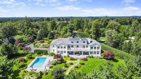 Chic European inspired home fronted by a gracious courtyard is secluded at end of a long, gated drive on one of the highest points in Greenwich. Striking modern architectural elements enhance the sophisticated 10,000+ sf interior with distant L.I Sou...