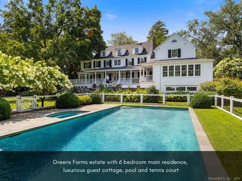 Premier Greens Farms estate majestically set on 2.6+/- acres of park-like property including a beautifully updated 6-BR main residence, luxurious guest cottage, gunite pool/spa & tennis court amid specimen landscaping & extensive stonework. The circu...