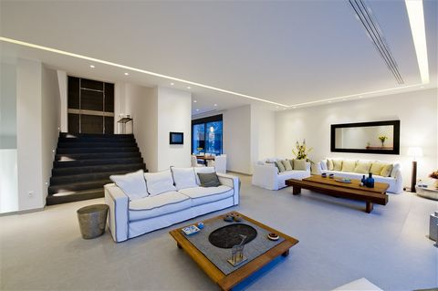 The transcendent combination of atmosphere and colors captivates from the first glance as the disarming simplicity of the shapes and lines of this residence invites you to explore. The villa escapes from stereotypes, combining the classic all-white o...