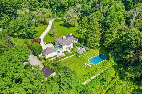 Private mini-estate on nearly 5 acres. A serene courtyard entrance welcomes you into this chic 1940's French country-side Chateau offering a unique blend of the character of yesteryear combined with today's transitional style. Elegant entertaining sp...